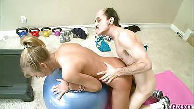 Chastity Lynn is laying flat on the yoga ball