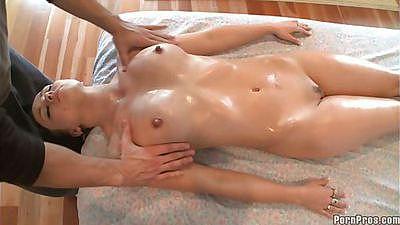 Big tits babe turns around to get a boob massage