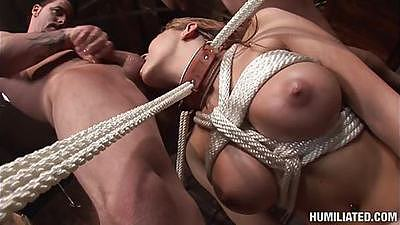 Chick tied up and forced to suck on some cock