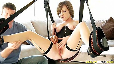 Bushy girl Katie sits on a sex swing and gets probed