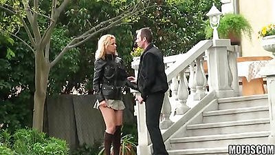 Couple goes to the railing to do doggy style