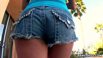 Hot milf Nikita Jaymes walking outdoors in her tight jean short
