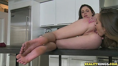 Lesbian Hayden Hawkens and s2 shaved pussy licking in the kitchen