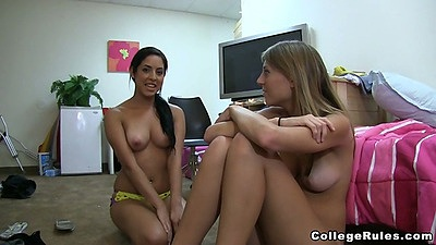 Two lesbian chicks sitting in their underwear on the floor
