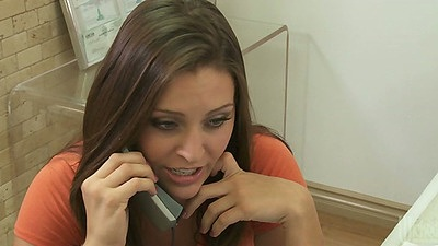 Brunette babe Stormy Daniels talks on the phone