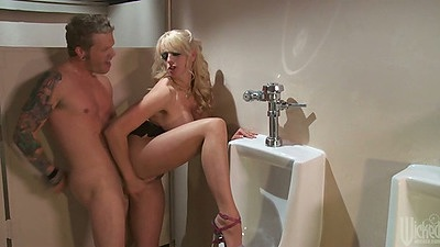 Stormy Daniels gets fucked on the urinal in mens bathroom