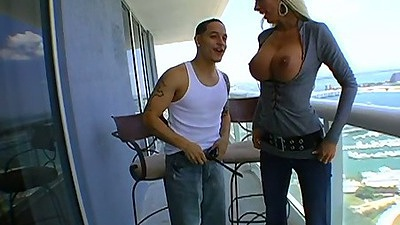 Blonde big tits babe Lichelle Marie going on the balcony with tits exposed