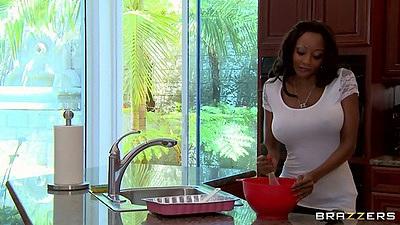 Ebony super milf goddess Diamond Jackson talking on the phone in kitchen