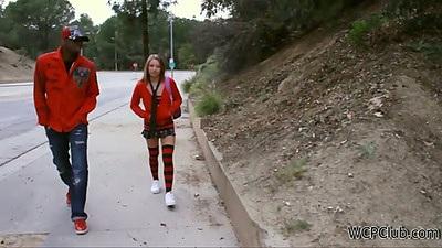 Young teen Alyssa Branch talking a walk on the street in school uniform picked up