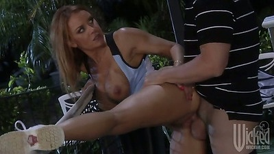Rear entry half dressed sex with Janet Mason outdoors on tennis court