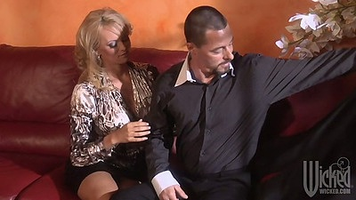 Milf Stormy Daniels all dressed but spreads her legs
