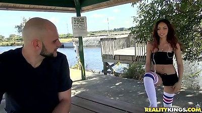 Outdoor athletic latina Emily Benjamins posing in tight shorts