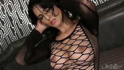 Solo fishnet babe Sunny Leone in seethrough lingerie