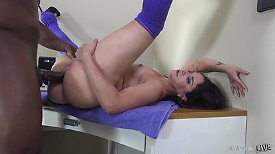 On the table drilling brunette girl Sheena Ryder in interracial fuck